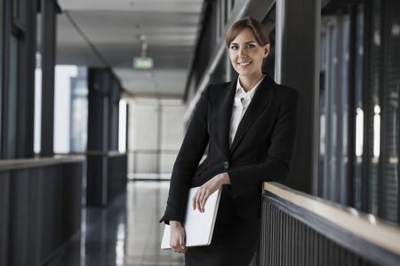 Smiling brunette businesswoman, portrait