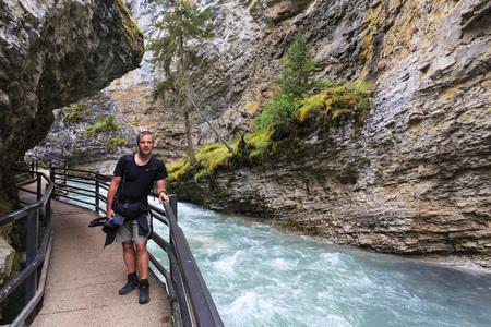 Canada, Alberta, Banff National Park, Johnston Creek, Johnston Canyon, tourist on footbridge
