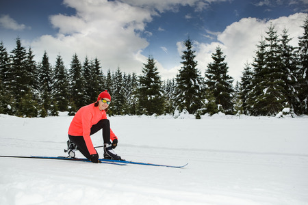 Germany, Thuringia, A woman cross-country skiing in the forest near Masserberg
