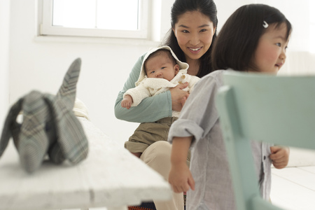 Asian mother with toddler and baby