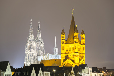 Germany, North Rhine-Westphalia, Cologne, view to lighted Cologne Cathedral and Great St Martin by night LANG_EVOIMAGES