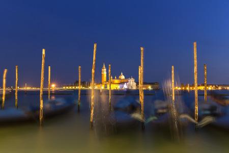 Italy, Venice, Gondolas at San Giorgio Maggiore at night