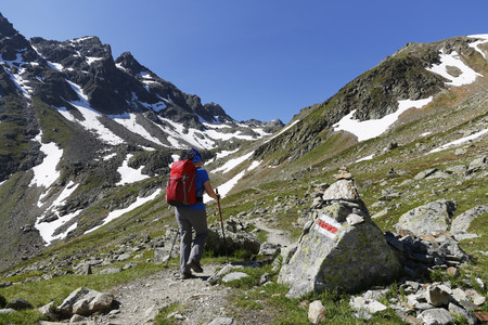 Austria, Vorarlberg, Woman hiking at Grafierjoch and Schafberg