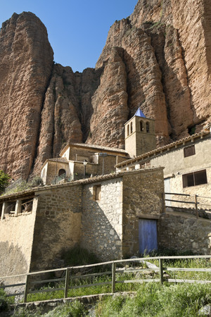 Spain, Aragon, Mallos de Riglos, Riglos, church and houses LANG_EVOIMAGES