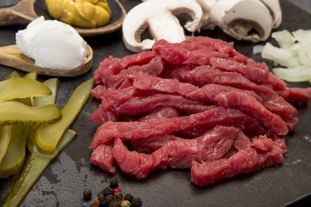 Ingredients for beef Stroganoff, studio shot