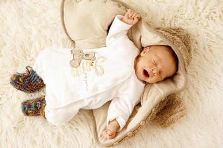 Newborn sleeping on sheepskin