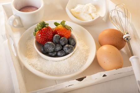 Tablet with bowls of ingredients for fruit cake LANG_EVOIMAGES