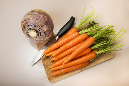 Turnip, carrots and knife on chopping board, low carb LANG_EVOIMAGES