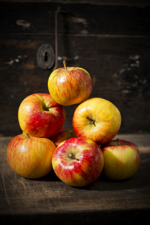 Pile of organic apples on wooden table