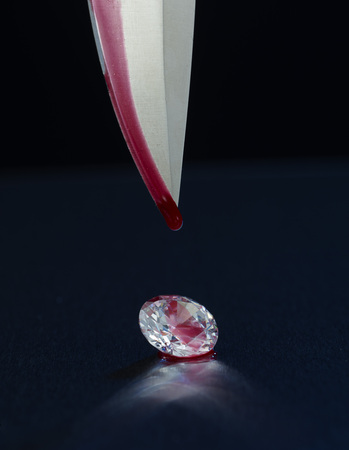 Blood dripping of a knife falling on a diamond LANG_EVOIMAGES