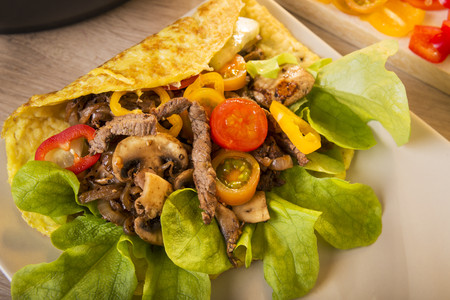 Kebab Omelette filled with beef, champignon, onions, salad and yoghurt dressing, Low Carb