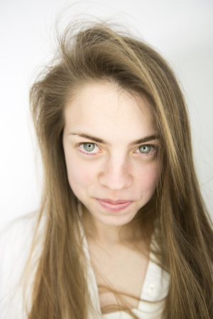 Portrait of smiling teenage girl with green eyes