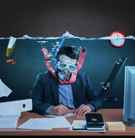 Office worker with snorkel, working under water
