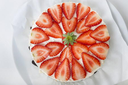 Garnished strawberry cream cheese tart, elevated view LANG_EVOIMAGES