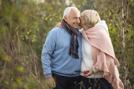 Portrait of happy senior couple having a walk