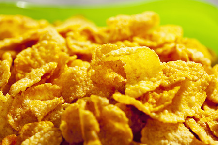Green bowl of cornflakes, close-up