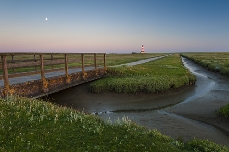 Germany, Schleswig-Holstein, North Sea Coast, View of Westerheversand Lighthouse LANG_EVOIMAGES
