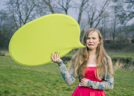 Germany, Landshut, Female teenager with green speech bubble LANG_EVOIMAGES