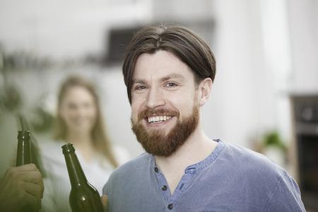 Friends in kitchen drinking beer