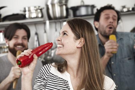 Friends preparing food and having fun in kitchen