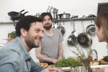 Happy friends in kitchen LANG_EVOIMAGES