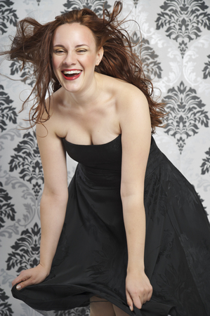 Portrait of young woman wearing little black dress LANG_EVOIMAGES
