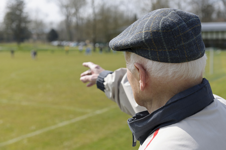 Old man watching football match LANG_EVOIMAGES