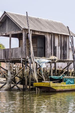 Indonesia, Riau Islands, Bintan Island, Fishing hut and fishing boat