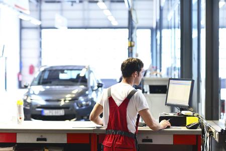Car mechanic in service area of a car workshop