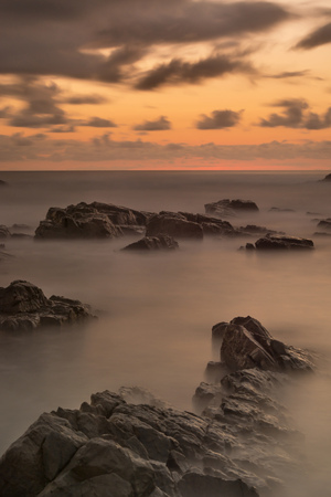 Australia, New South Wales, Tweed Shire, break of dawn at the rocky shore of Hastings Point