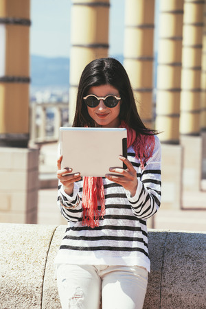 Spain, Barcelona, Young woman using digital tablet