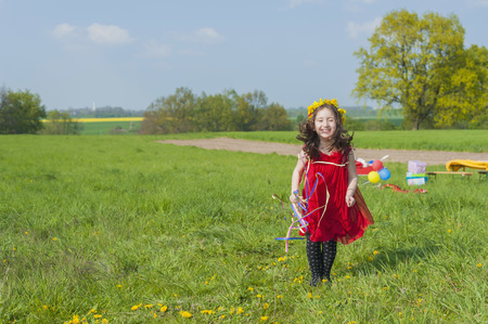 Little girl standing on a meadow