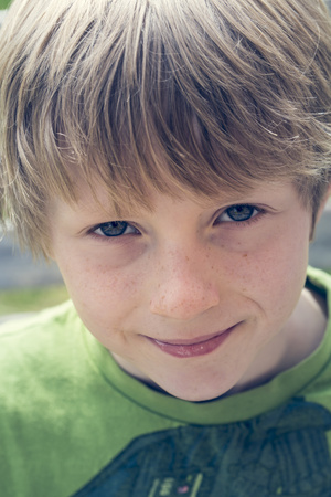 Portrait of smiling boy with freckles