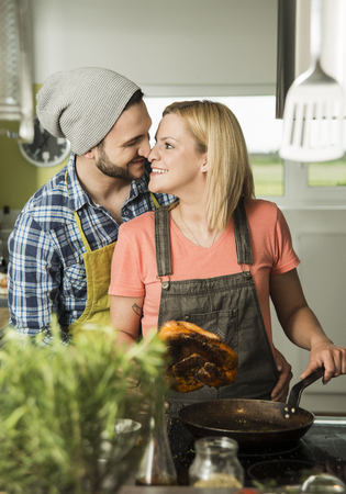 Couple in love cooking in kitchen at home
