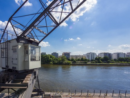 Germany, Hesse, Frankfurt, view over Main river to Sachsenhausen with old harbour crane in the foreground