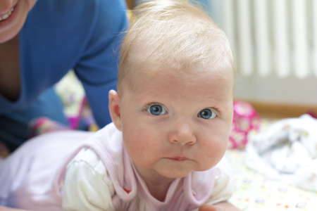 Portrait of crawling baby girl
