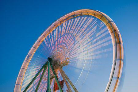 Germany, North Rhine-Westphalia, Cologne, part of lighted turning big wheel at blue hour