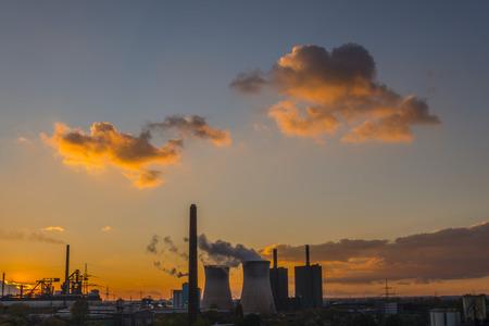 Germany, North Rhine-Westphalia, Duisburg Huettenheim, view to steel mill and Huckingen gas power station by twilight