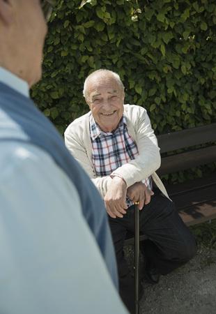 Portrait of happy old man witk walking stick LANG_EVOIMAGES