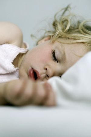 Germany, Berlin, blond girl sleeping