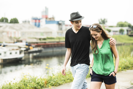 Portrait of young couple walking