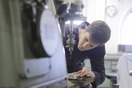 Germany, Young mechanic working in crafts workshop LANG_EVOIMAGES