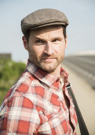 Germany, Mannheim, Man with cap, portrait