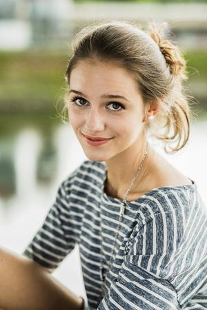 Portrait of happy teenage girl LANG_EVOIMAGES