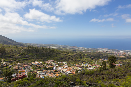 Spain, Canary Islands, Tenerife, View to Mountain Village Chirche, Guia de Isora right and Porto San Juan