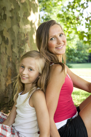 Germany, Berlin, Mother in park with daughter