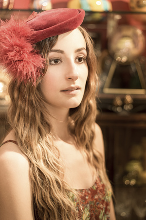 Portrait Of Young Woman Wearing Red Old Hat