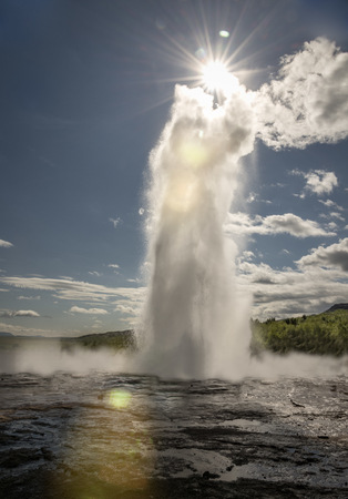 Iceland, Haukadalur, Strokkur, Fountain Geyser Against The Sun