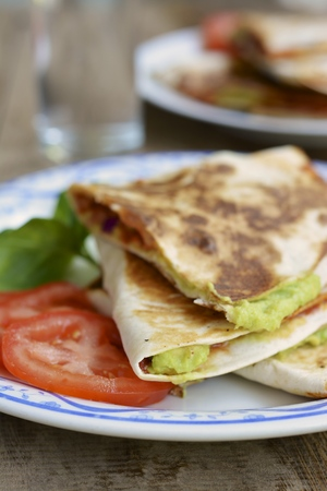 Tortilla Wraps With Home Made Guacamole And Tomato Slices