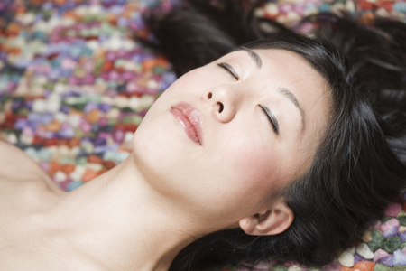 Portrait Of Sleeping Asian Woman In Front Of Colourful Ground